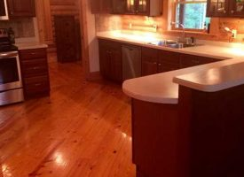 Come to the country on this 100 acres with beautiful log home